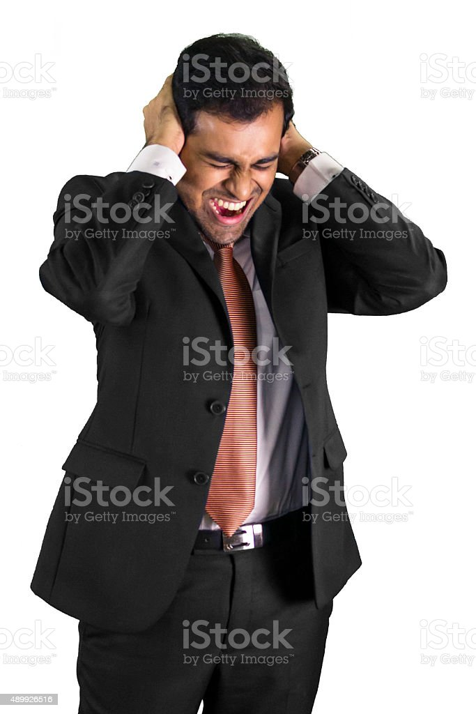 Frustrated professional man shouting stock photo