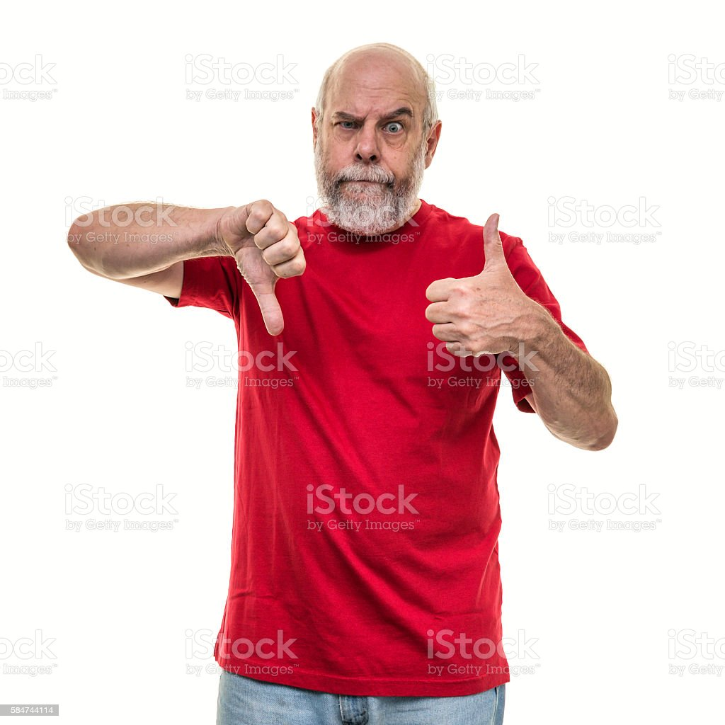 Frustrated Red Shirt Senior Man Giving Conflicting Thumbs Hand Gestures stock photo