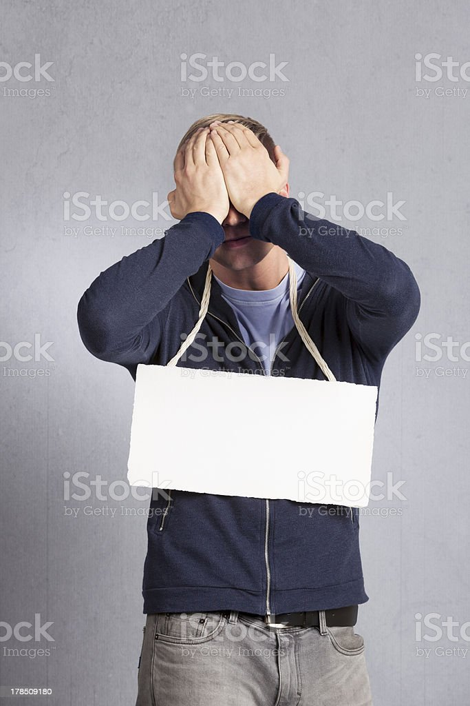Frustrated sad man presenting blank signboard. royalty-free stock photo