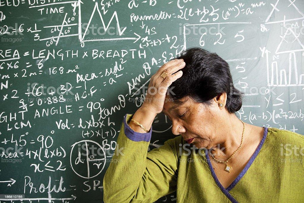 Frustrated Senior Indian Mathematics Teacher in pain royalty-free stock photo