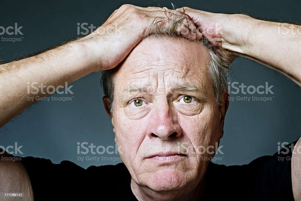 Frustrated Senior Man Exasperated stock photo
