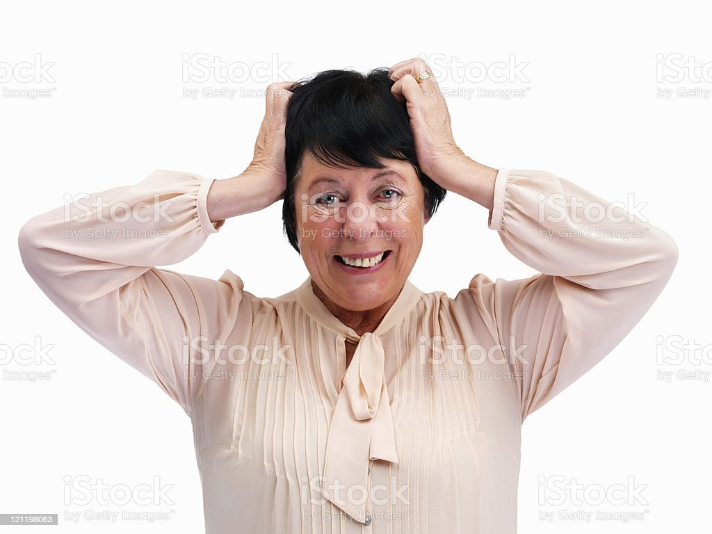 Frustrated senior woman grabbing her head over white stock photo