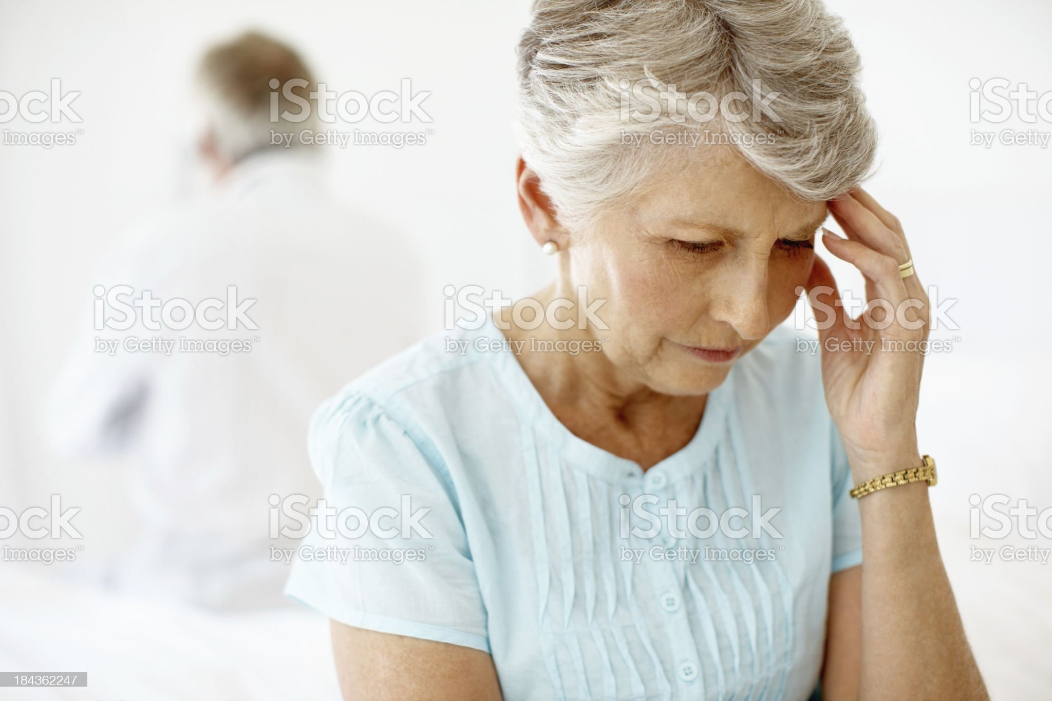 Frustrated senior woman with man royalty-free stock photo