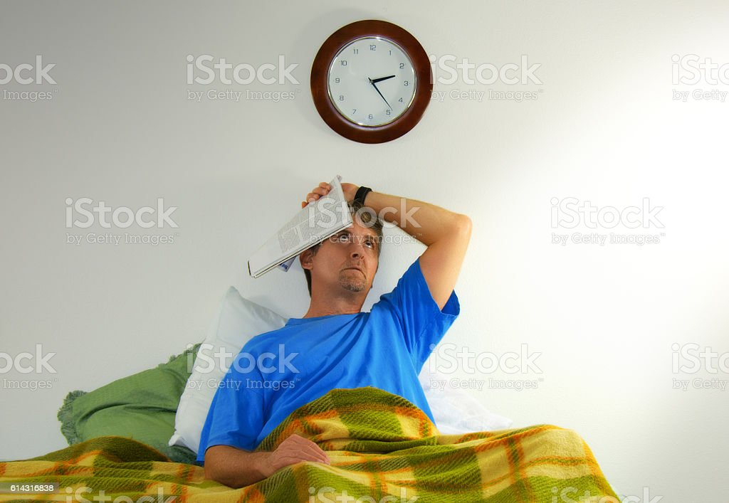 Frustrated stressed out man with insomnia stock photo