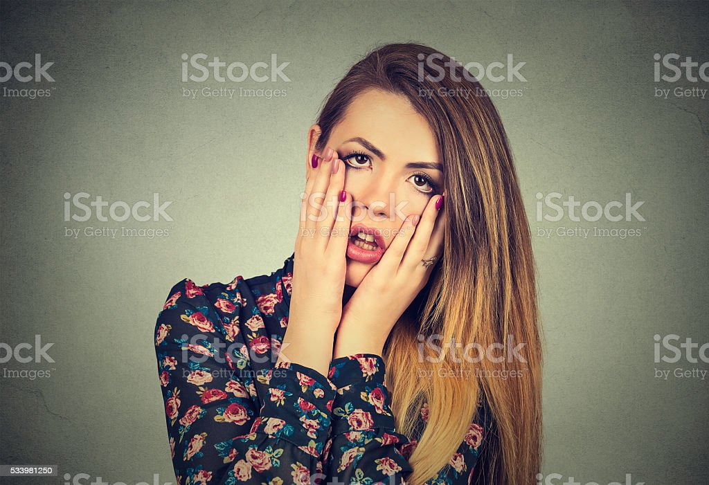 frustrated stressed woman with hands on face stock photo