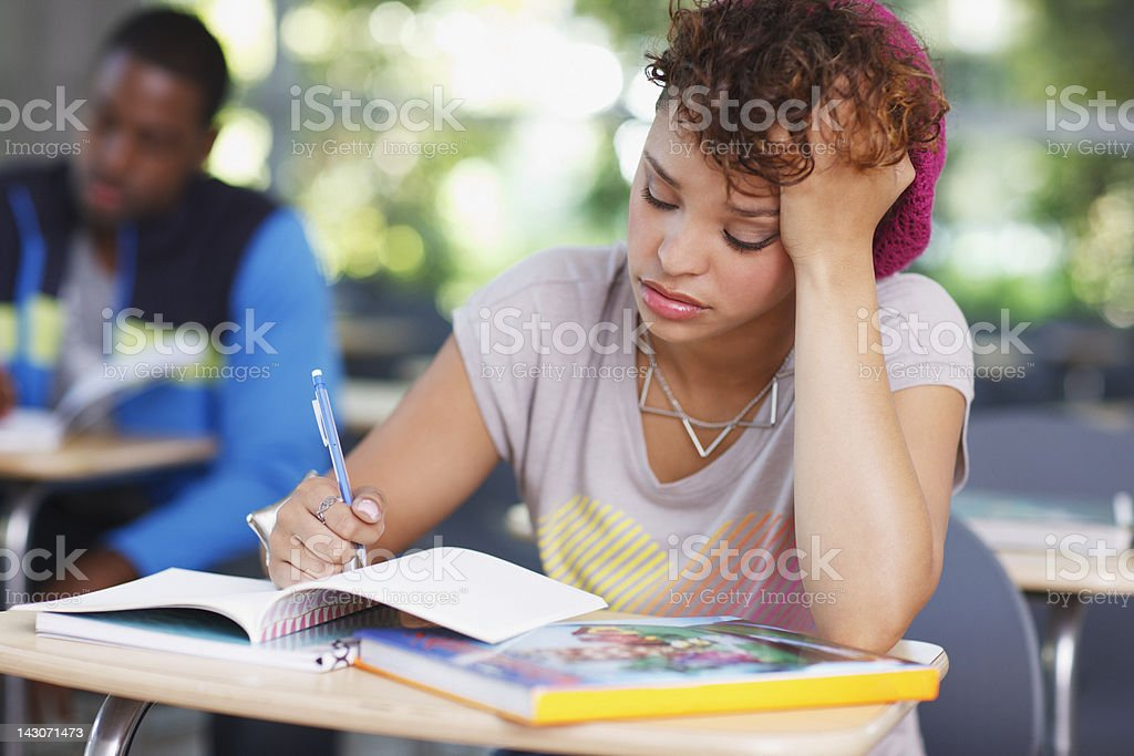 Frustrated student at work in classroom royalty-free stock photo