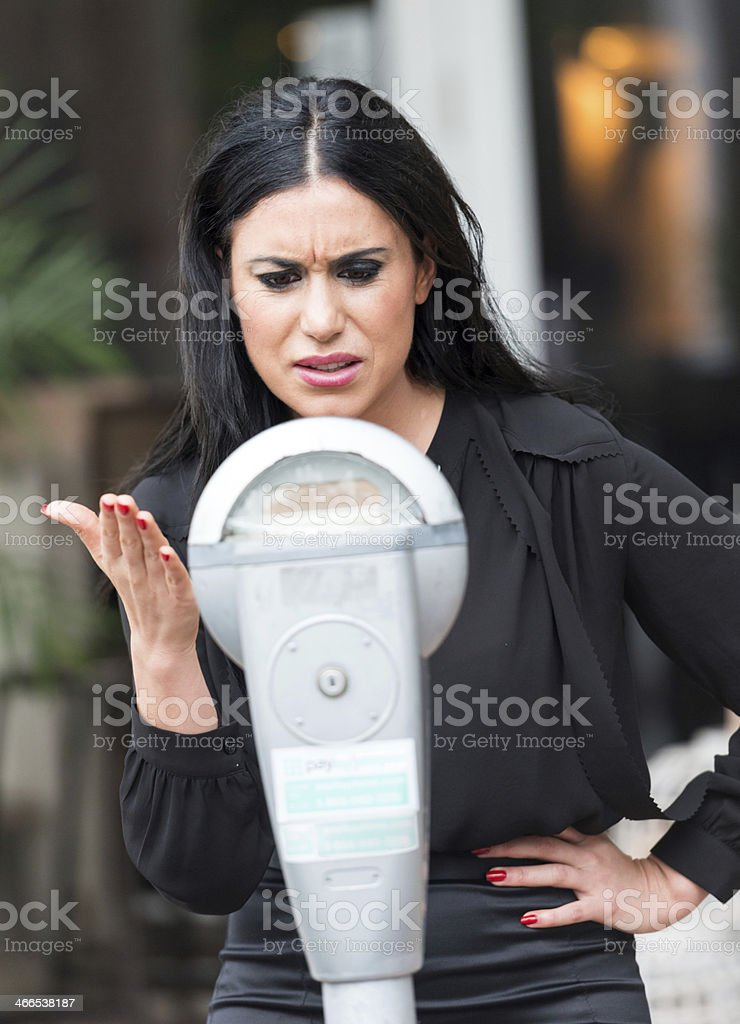 Frustrated with park meter royalty-free stock photo