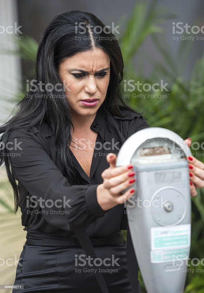 Frustrated with parking meter stock photo