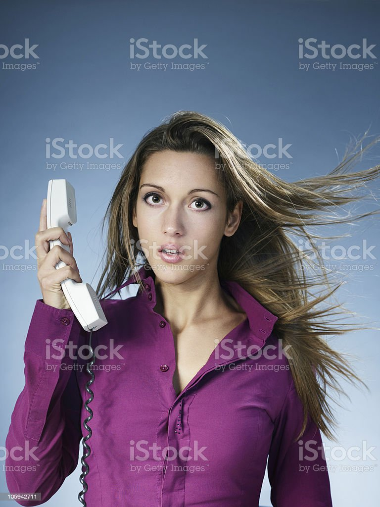 frustrated woman being yelled over the phone royalty-free stock photo