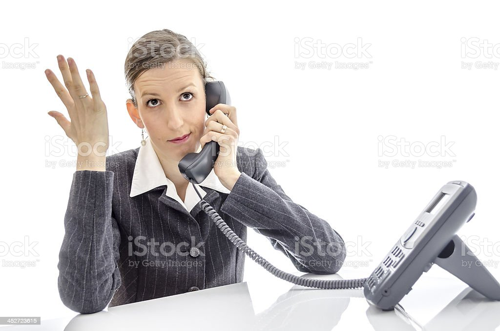 Frustrated woman making a phone call stock photo