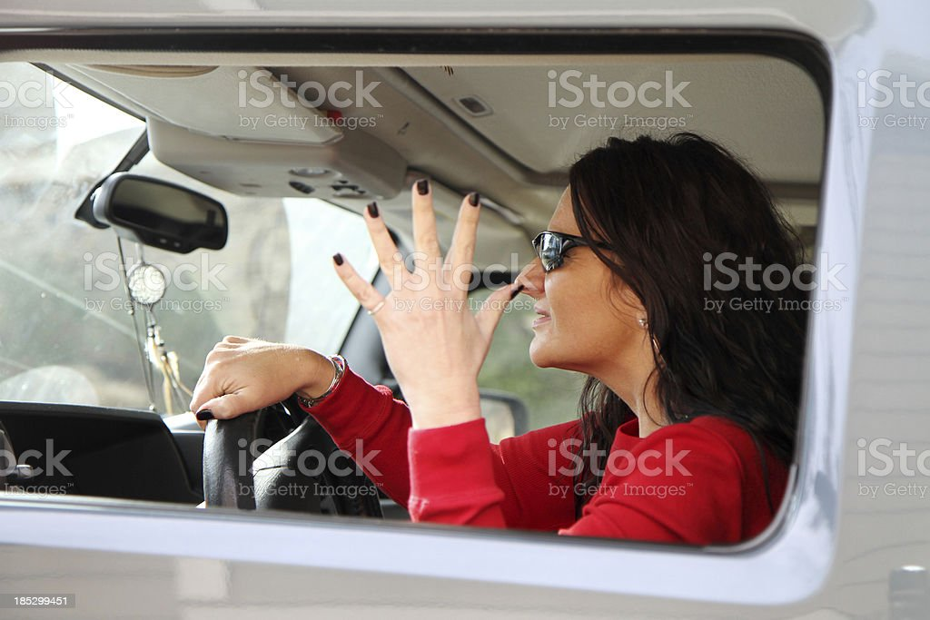 Frustrated Woman Sitting In Traffic stock photo