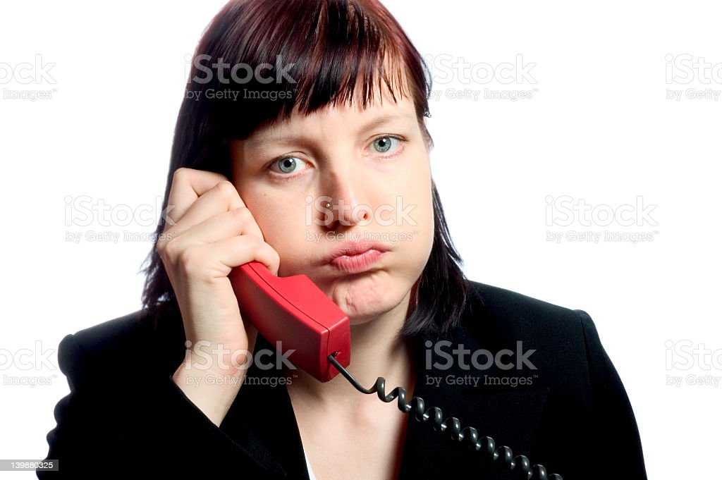 Frustrated woman talking over the phone royalty-free stock photo