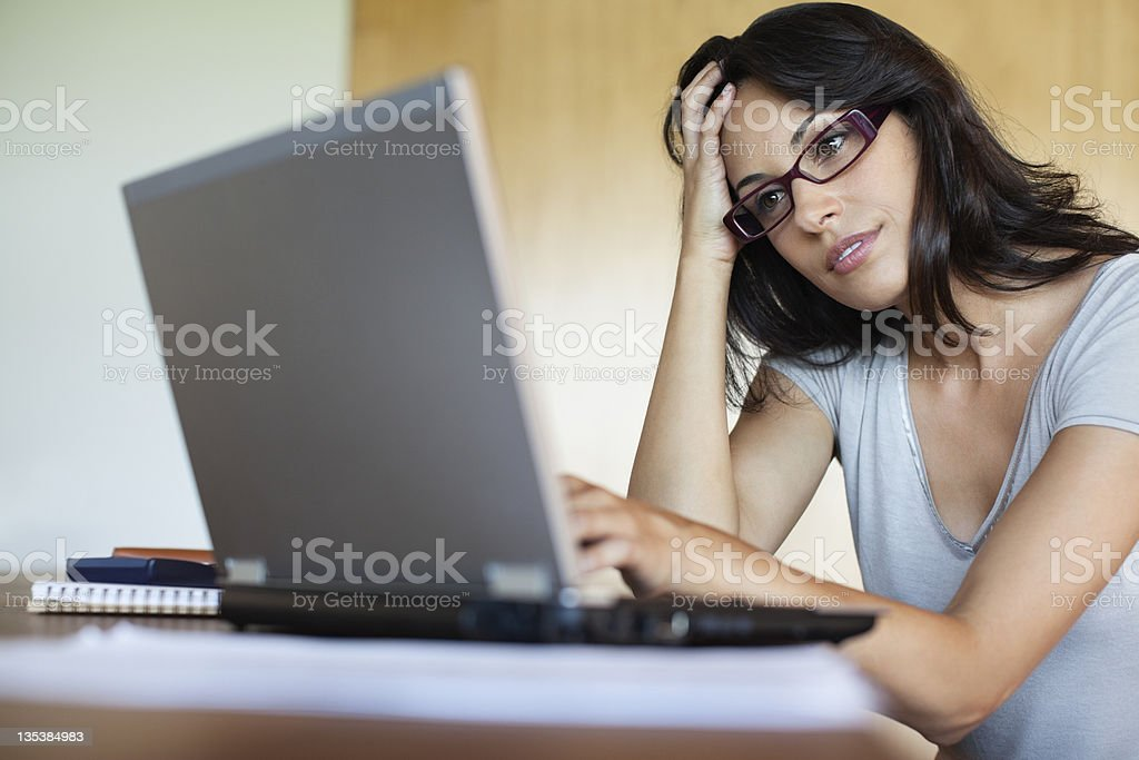 Frustrated woman using laptop royalty-free stock photo