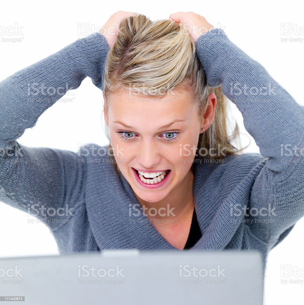 Frustrated woman with a laptop on white  royalty-free stock photo