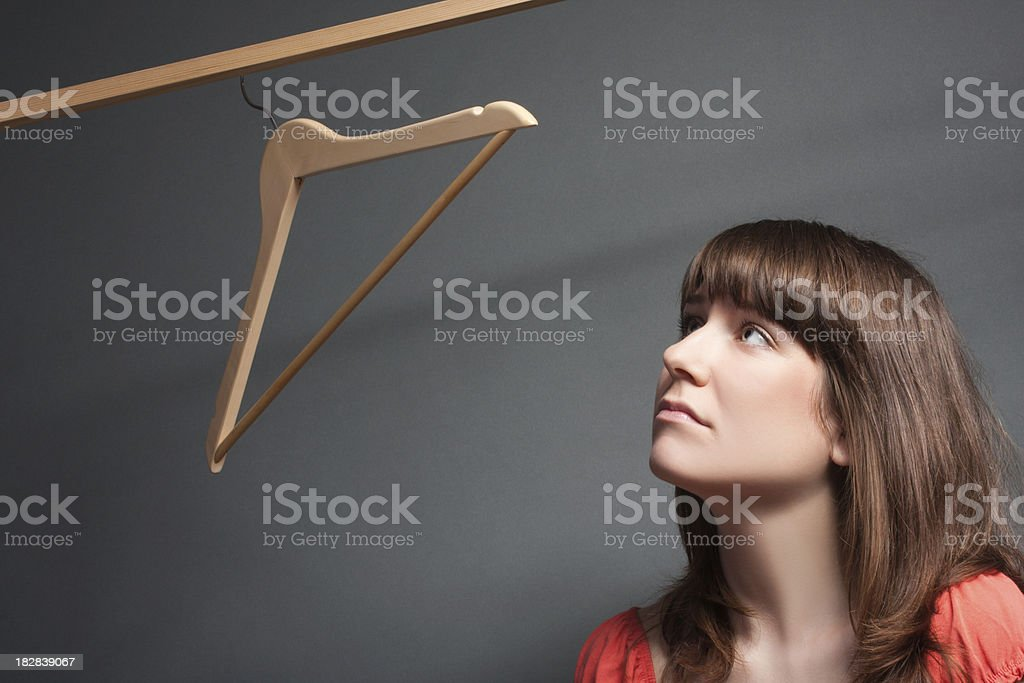 frustrated woman with empty hanger stock photo