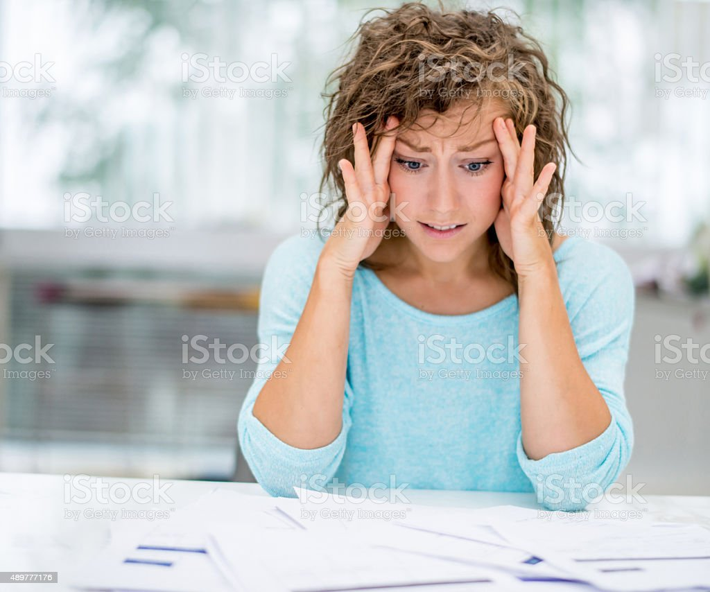 Frustrated woman working at home stock photo