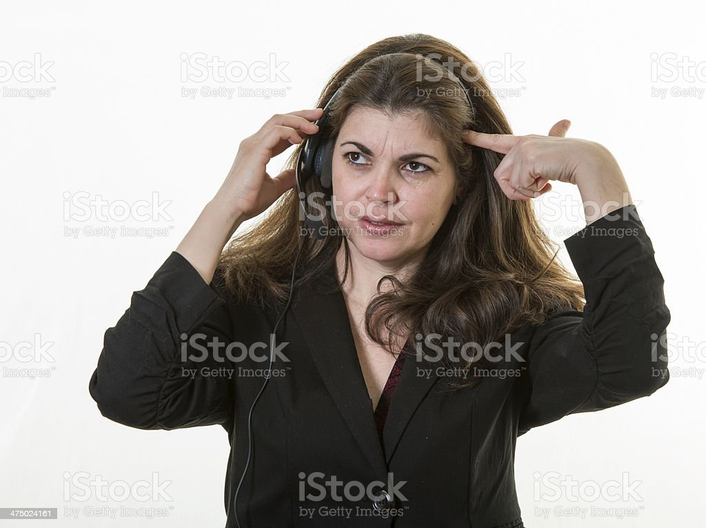 Frustrated woman working in a call center royalty-free stock photo