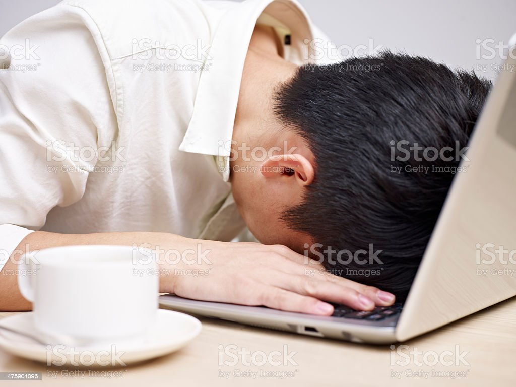 frustrated young asian businessman stock photo