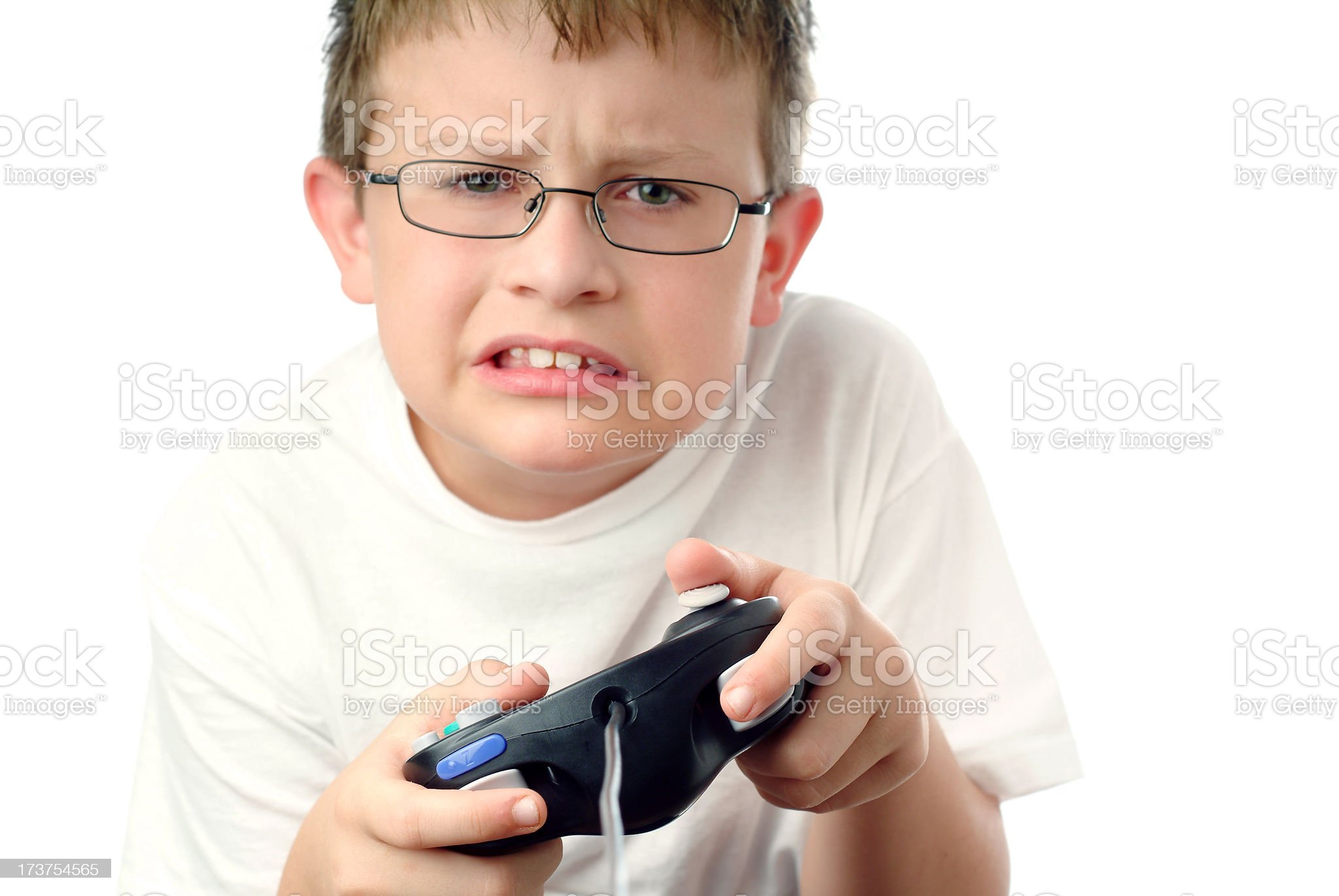 Frustrated Young Boy with Video Game Controller in his Hands royalty-free stock photo