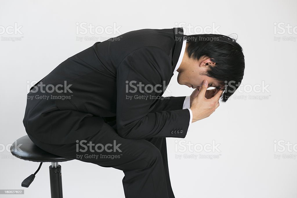 frustrated young business man with head in hands royalty-free stock photo