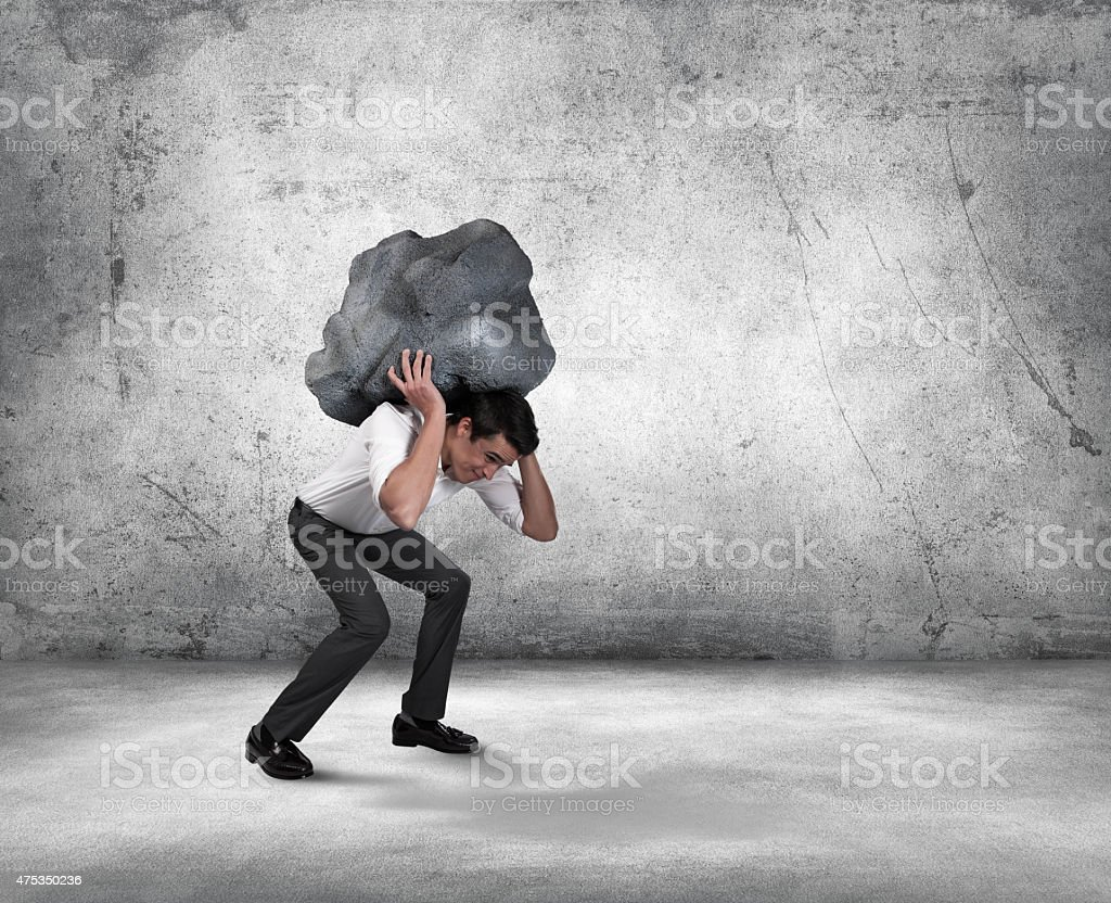 Frustrated Young Businessman Carrying Stress stock photo