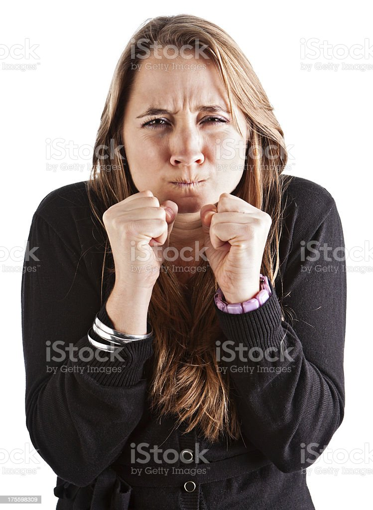 Frustrated young  businesswoman grimaces and clenches fists stock photo