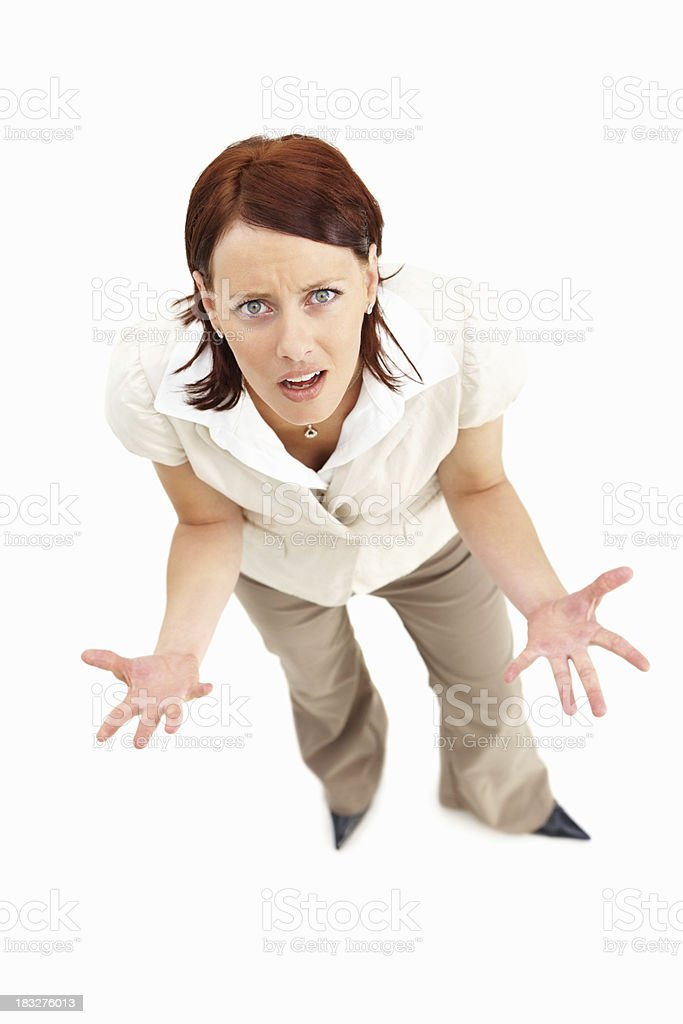 Frustrated young female executive against white background royalty-free stock photo