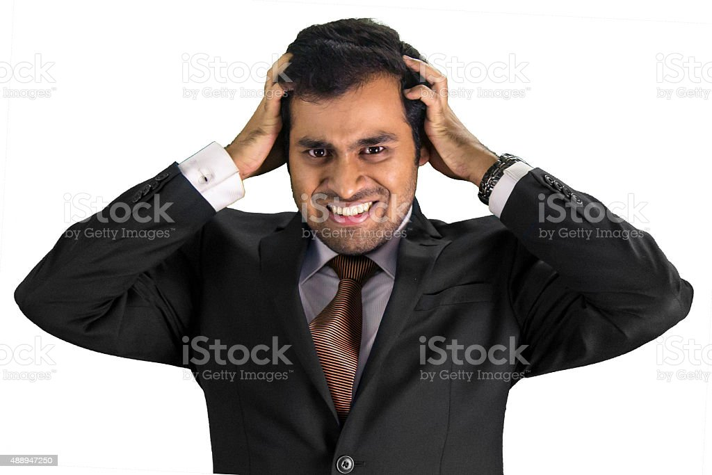 Frustrated young professional business man stock photo