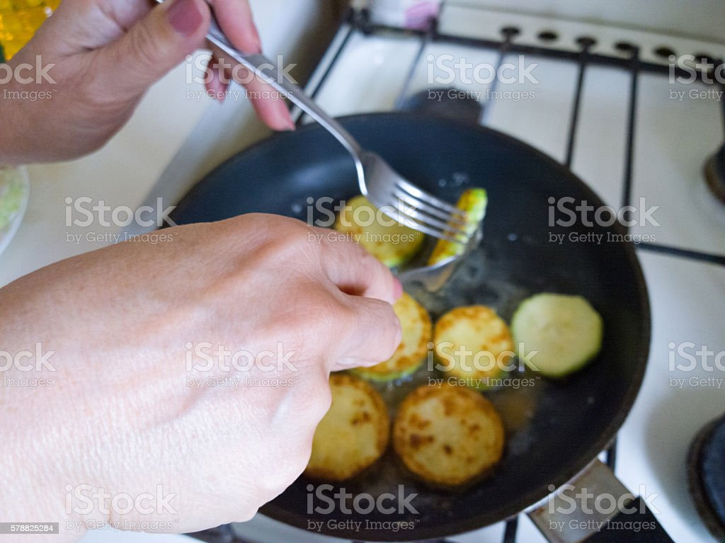 Fry courgettes. stock photo