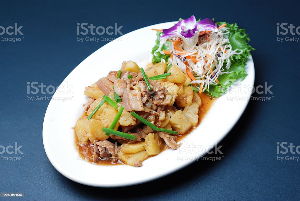 Fry pork with pineapple stock photo