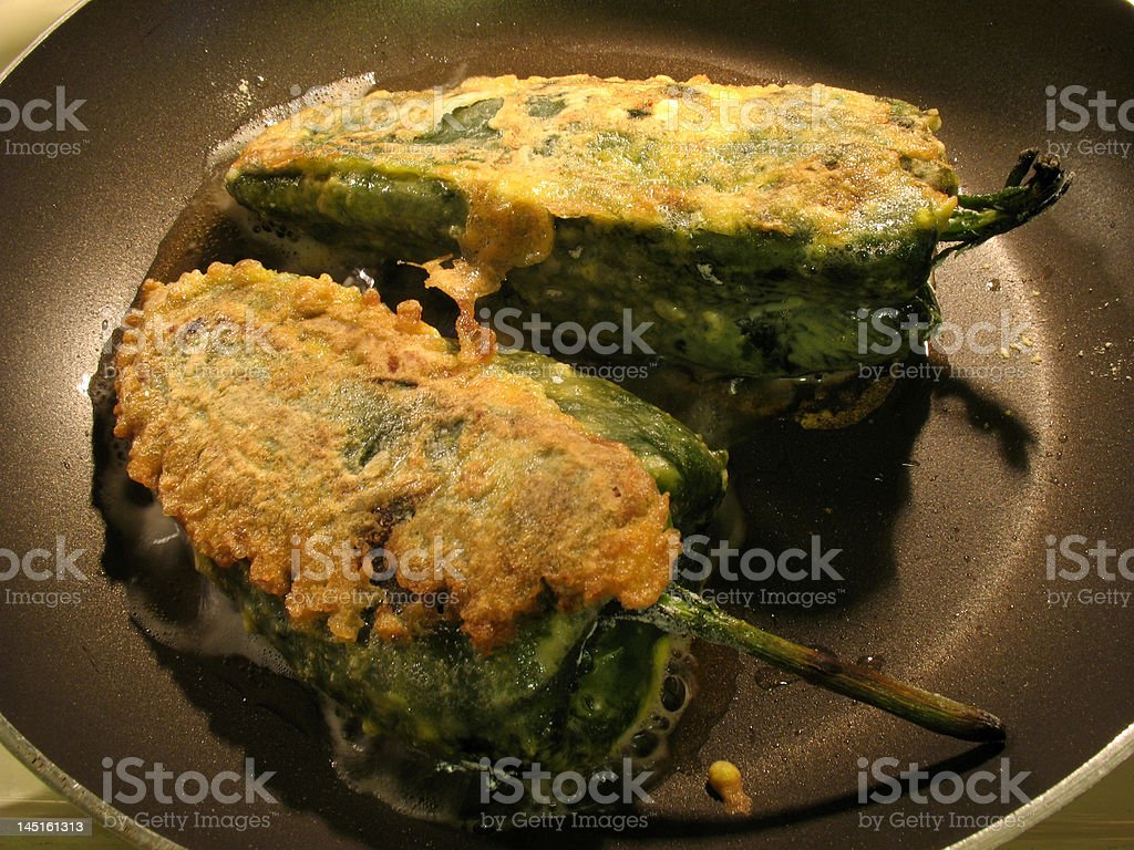 Frying Chile Rellenos stock photo