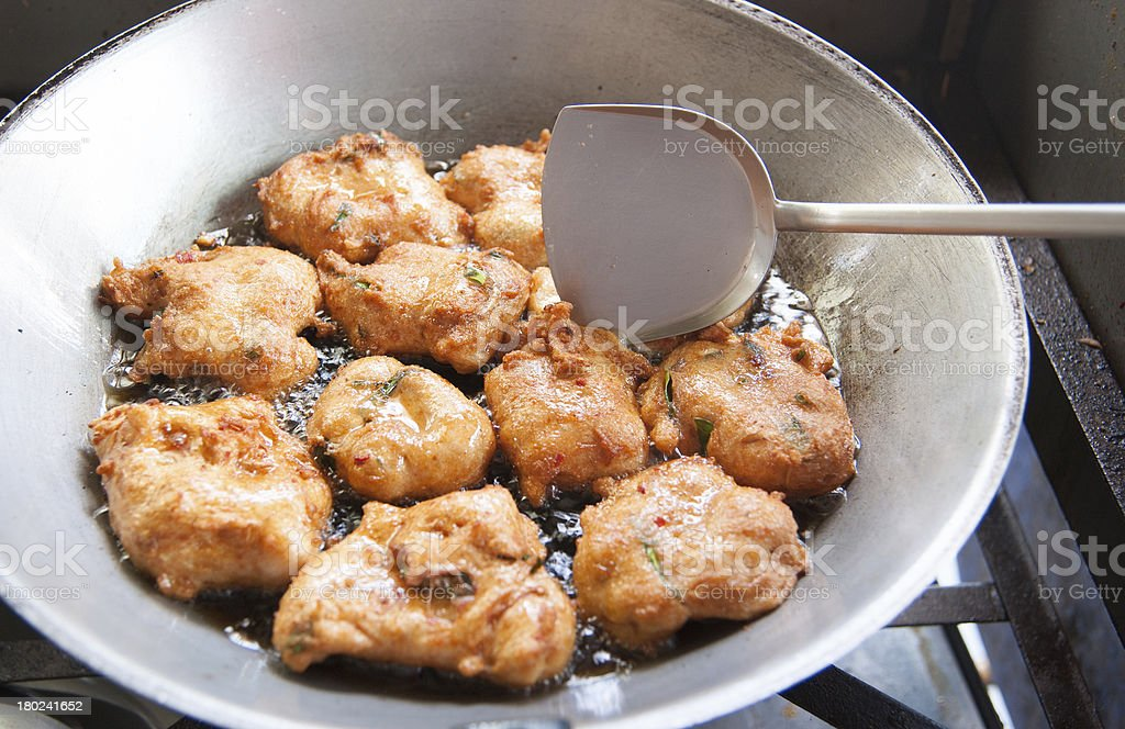 Frying corn meal mush in hot oil stock photo