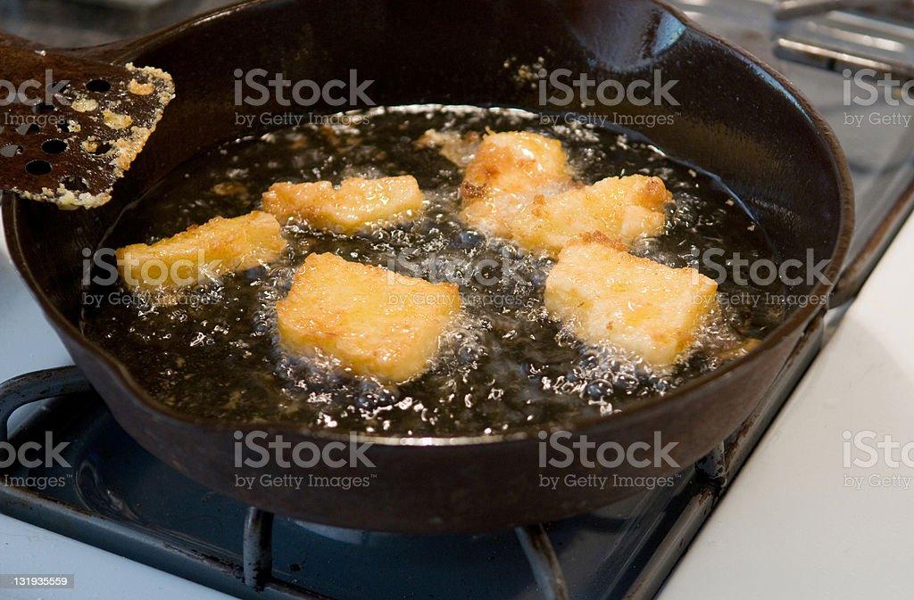 frying corn meal mush stock photo