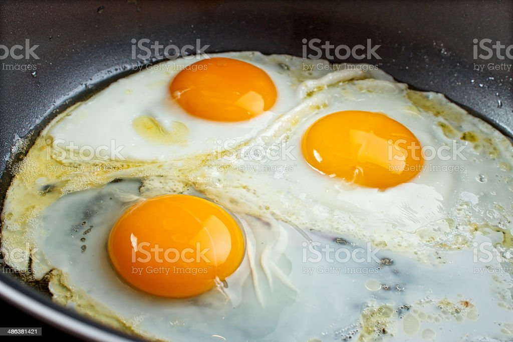 Frying eggs royalty-free stock photo