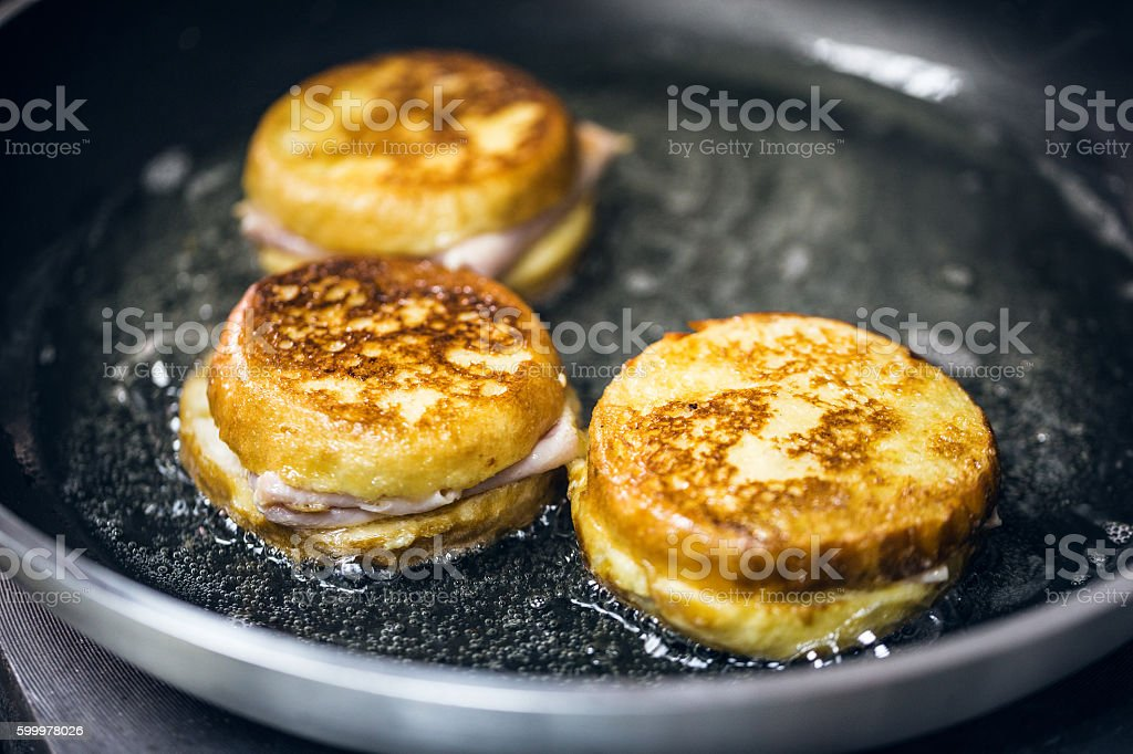 Frying monte cristo sandwich stock photo