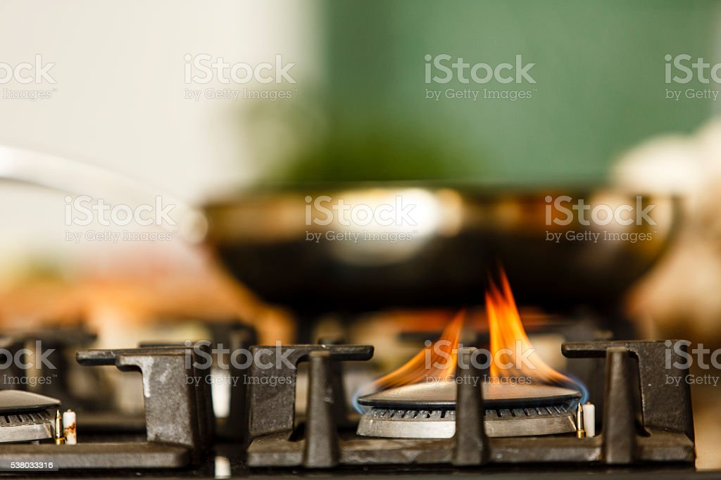 Frying pan on gas stove stock photo