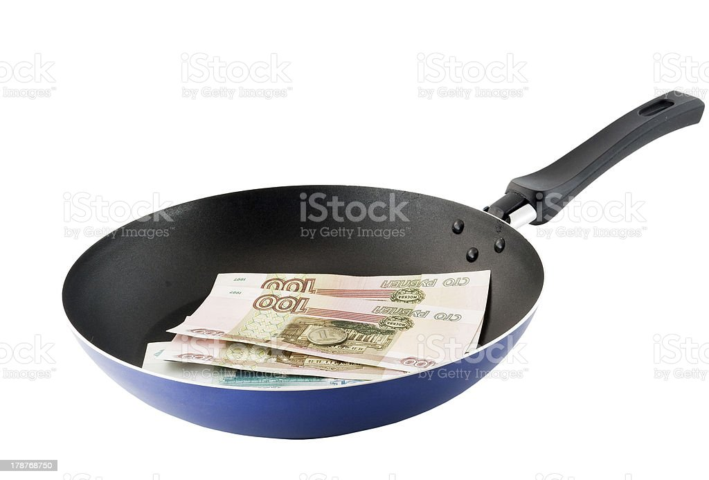 Frying pan with the russians moneys- roubles. royalty-free stock photo