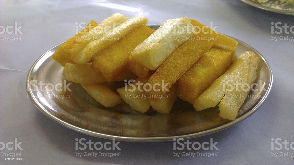 frying polenta and cassava stock photo