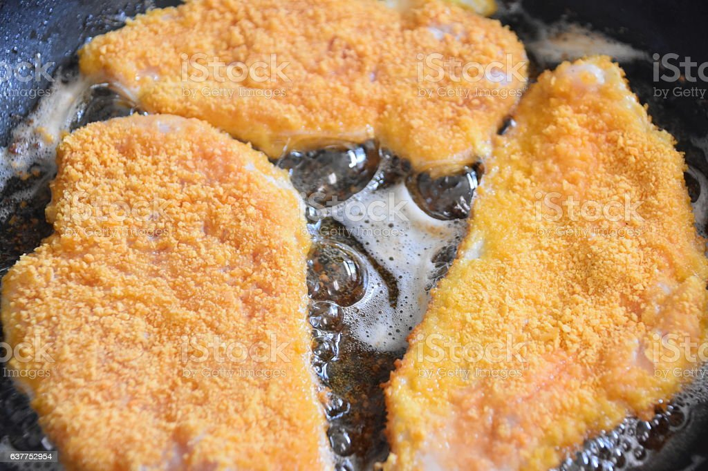 Frying schnitzel stock photo
