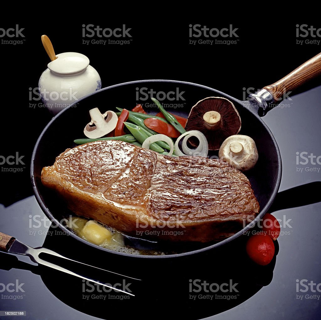 Frying Steak royalty-free stock photo