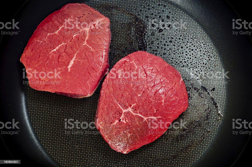 Frying Steaks stock photo