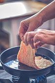 Frying Wiener Schnitzel in Deep Oil in a Cooking Pan