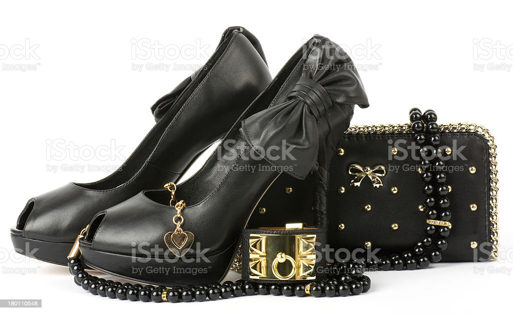 Fshionable shoes, golden jewelry and handbag. royalty-free stock photo