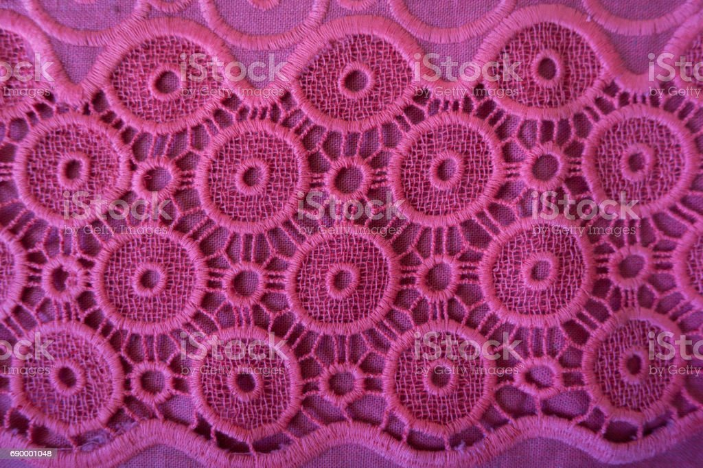 Fuchsia crochet lace fabric with circular pattern stock photo