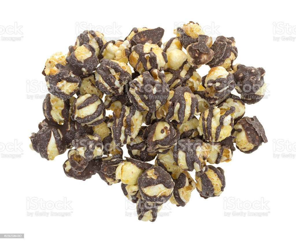 Fudge drizzled popcorn on a white background stock photo