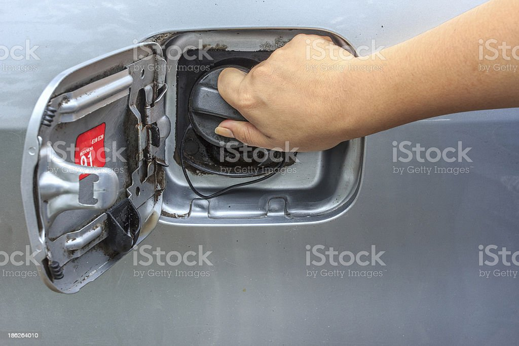 Fuel cap in female hand royalty-free stock photo