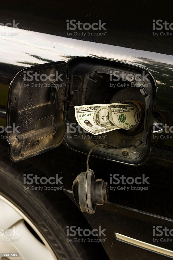 Fuel costs, vertical stock photo