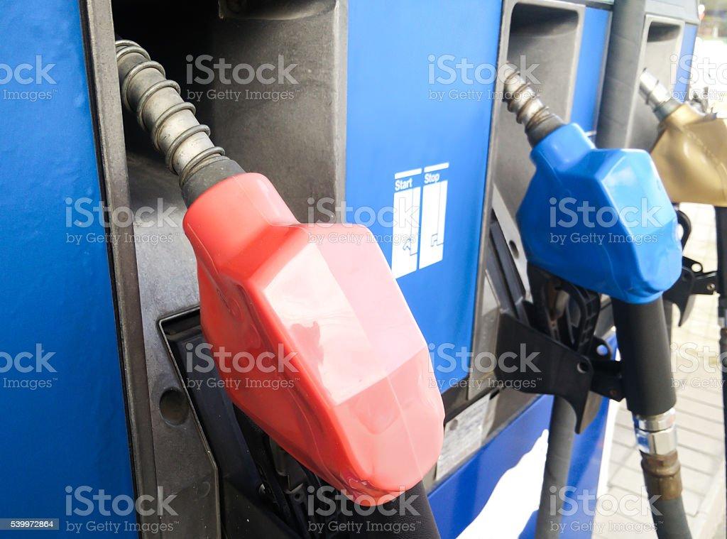 Fuel dispenser at petrol filling station stock photo