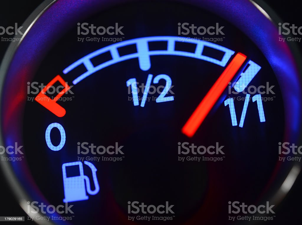 Fuel gauge in neon lights showing an almost full tank stock photo
