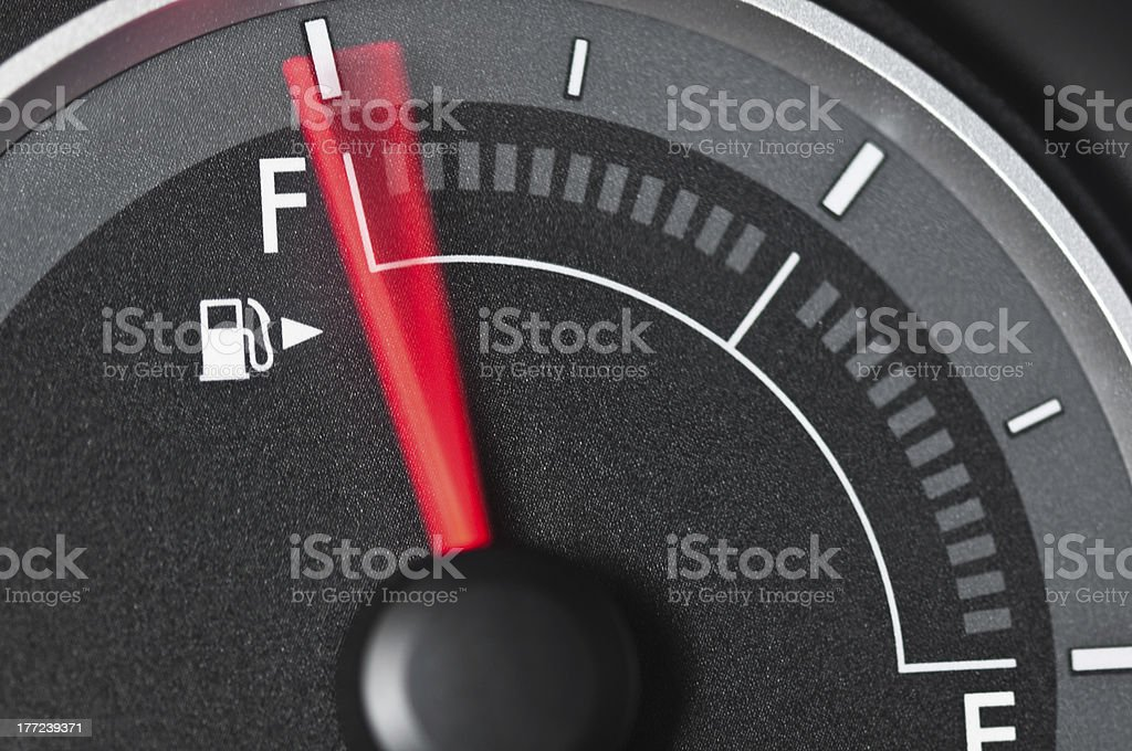 Fuel Gauge with motion blurred needle stock photo